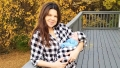 amy duggar holding her son dax wearing matching plaid