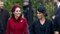 kate middleton wears a red a-line coat with a matching beret white meghan markle wears navy blue coat with matching hat. meghan markle and kate middleton will be civil at remembrance day events