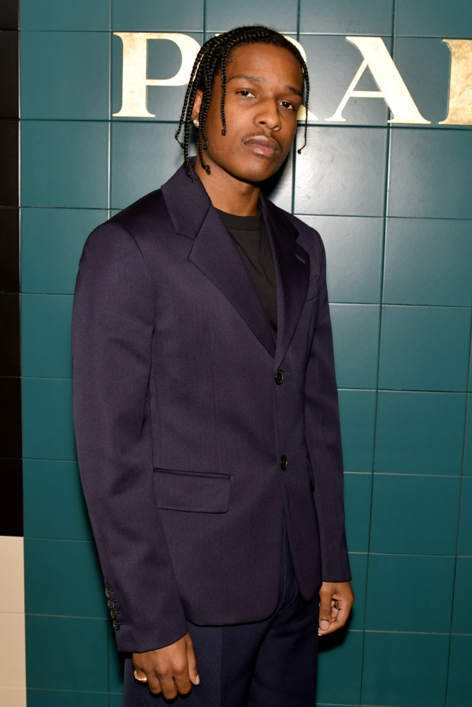 ASAP Rocky Wearing a Suit in Front of a Green Wall