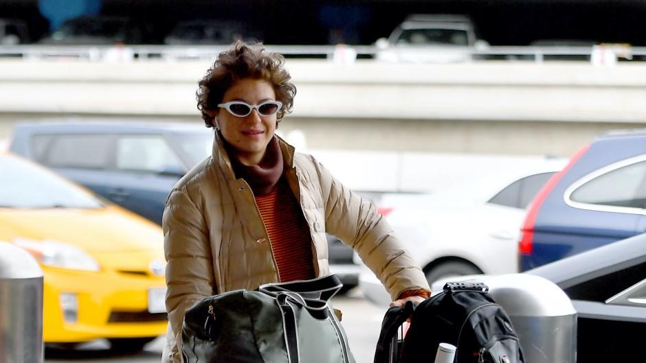 Alia Shawkwat Wearing a Puffy Coat and Sunglasses at LAX