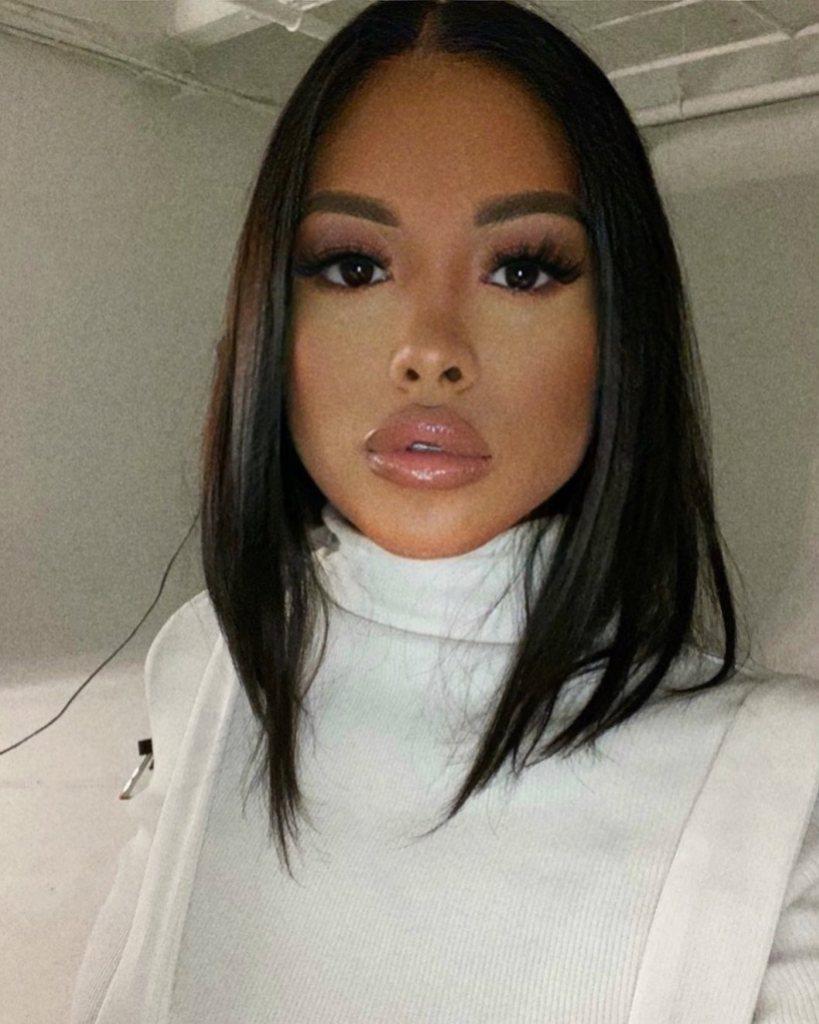 Ammika Harris Wearing a White Sweater