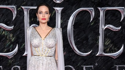 Angelina Jolie Wearing a Purple Dress on a Red Carpet