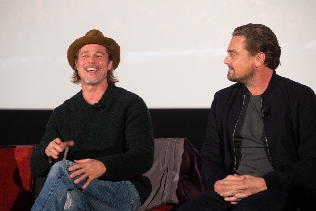 Brad Pitt Wearing a Hat With Leonardo DiCaprio on Stage