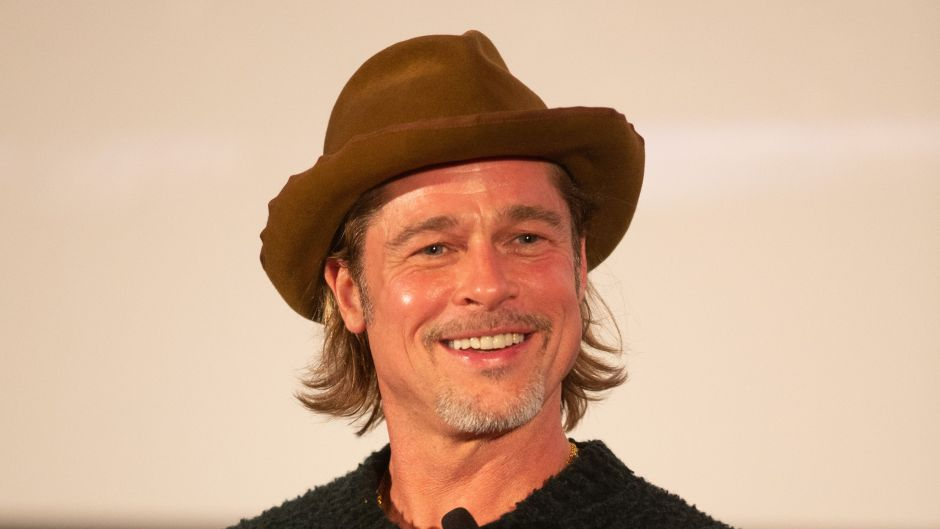 Brad Pitt Wearing a Hat With a Crowd of People in LA