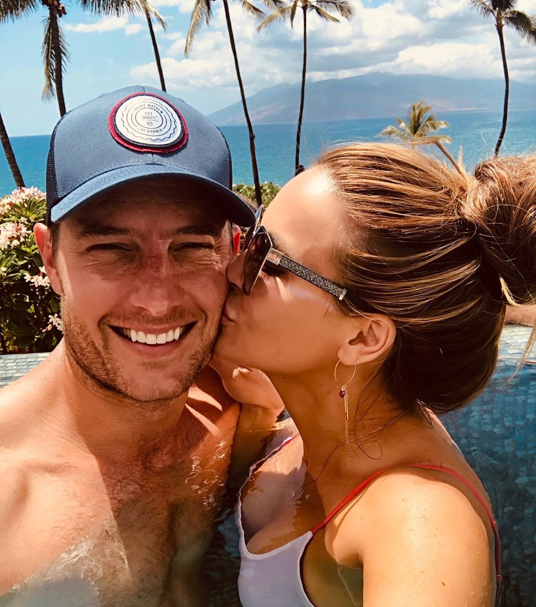 Chrishell Stause and Justin Harley Kissing in a Pool