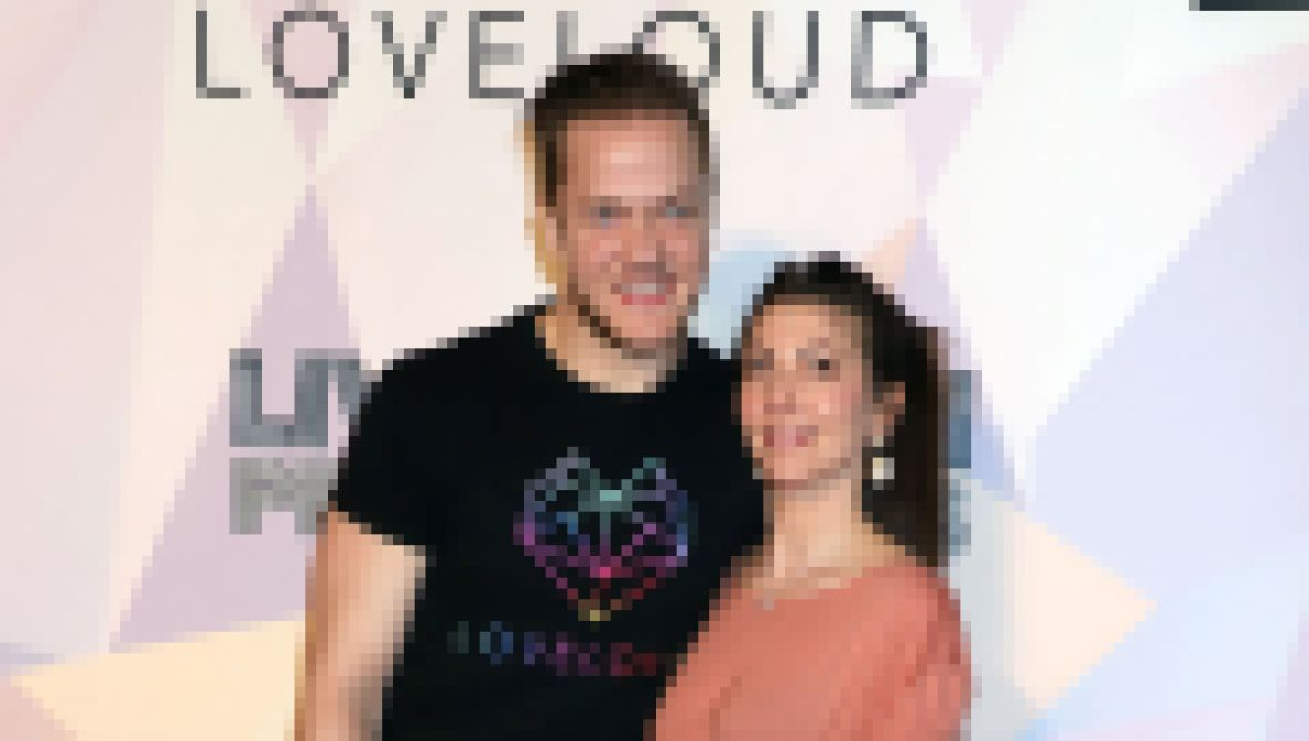 Dan Reynolds With His Wife at an Event