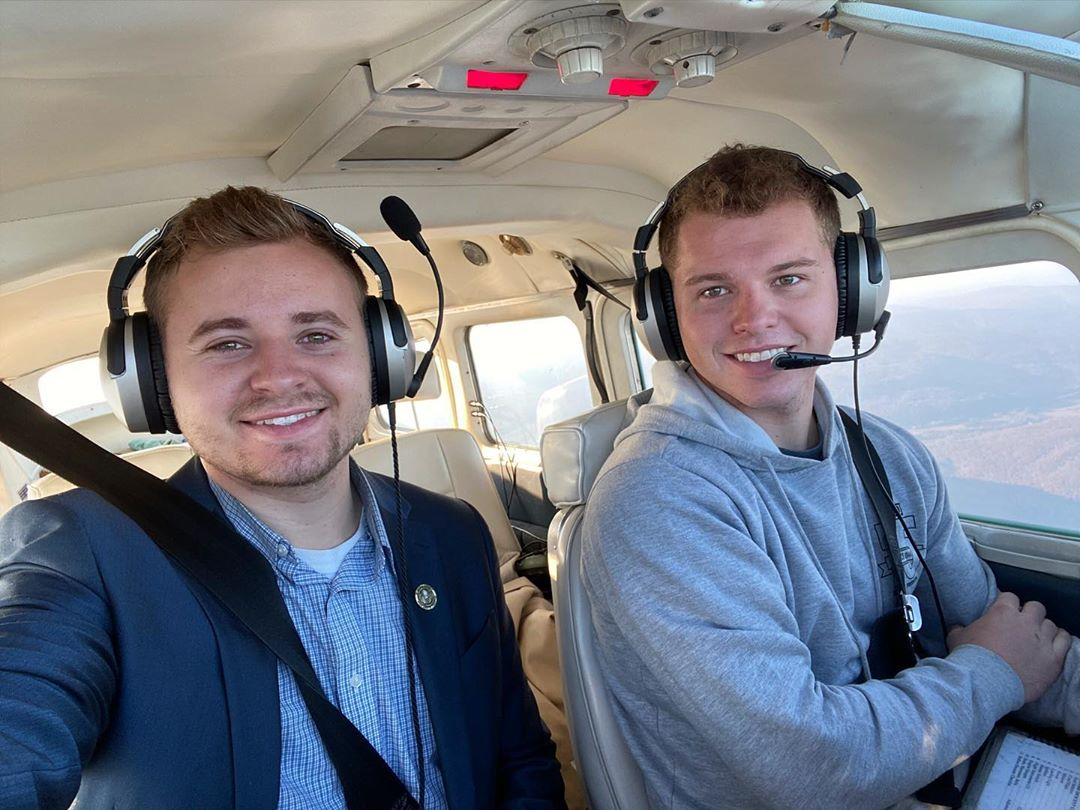 Jedidiah and Jeremiah Duggar in a Plane