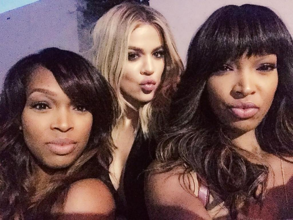 Khloe Kardashian Making a Kissy Face With Khadijah and Malika Haqq