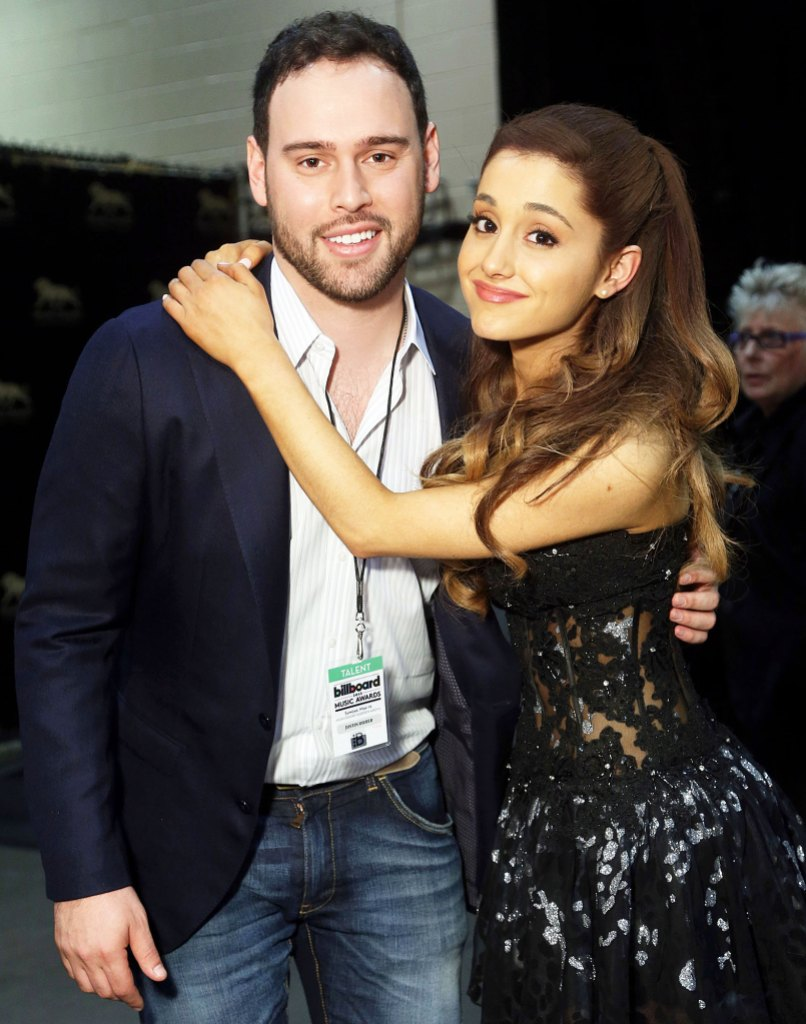 Scooter Braun and Ariana Grande at the 2013 Billboard Music Awards Taylor Swift Fans Slam Scooter Braun for Praising Ariana Grandes Live Tour Album Drop