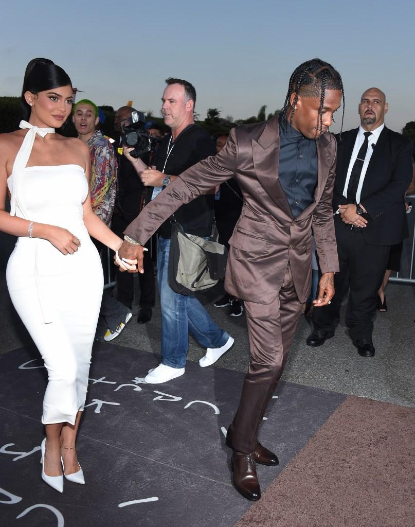Kylie Jenner Wearing a White Dress With Travis Scott