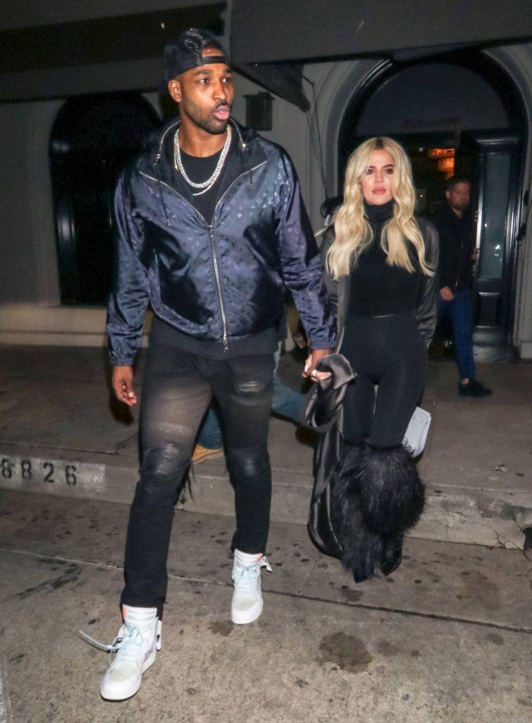 Tristan Thompson Wearing a Blue Jacket With Khloe Kardashian in Black
