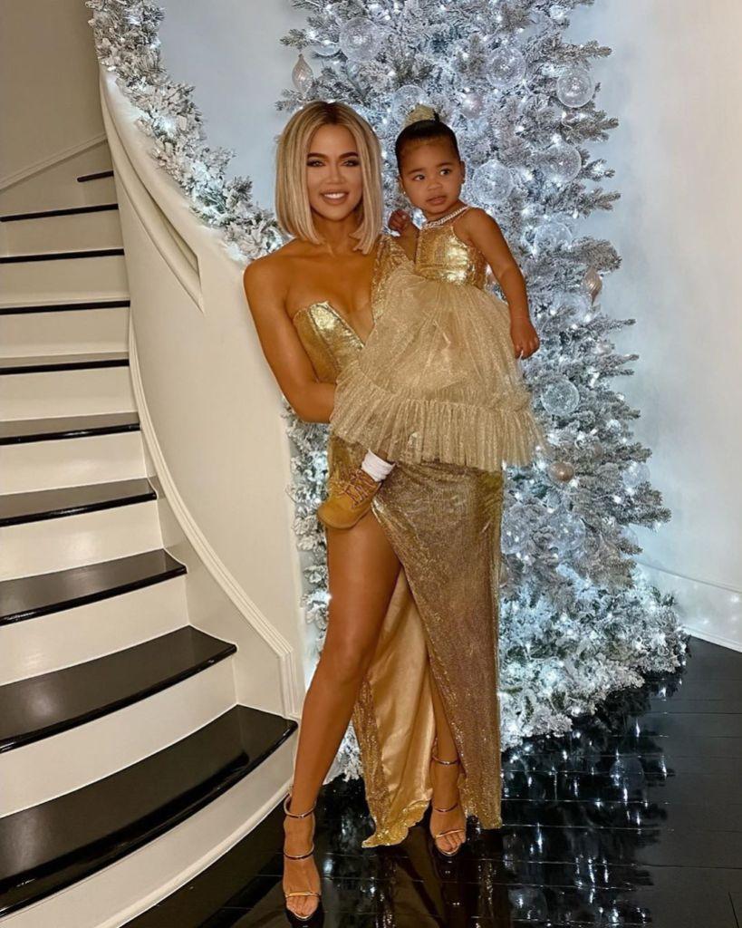Khloe Kardashian With True Thompson in Gold Dresses