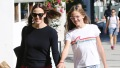 violet Affleck Wearing a White T-Shirt With Her Mom Jennifer Garner in a Black and Red Outfit