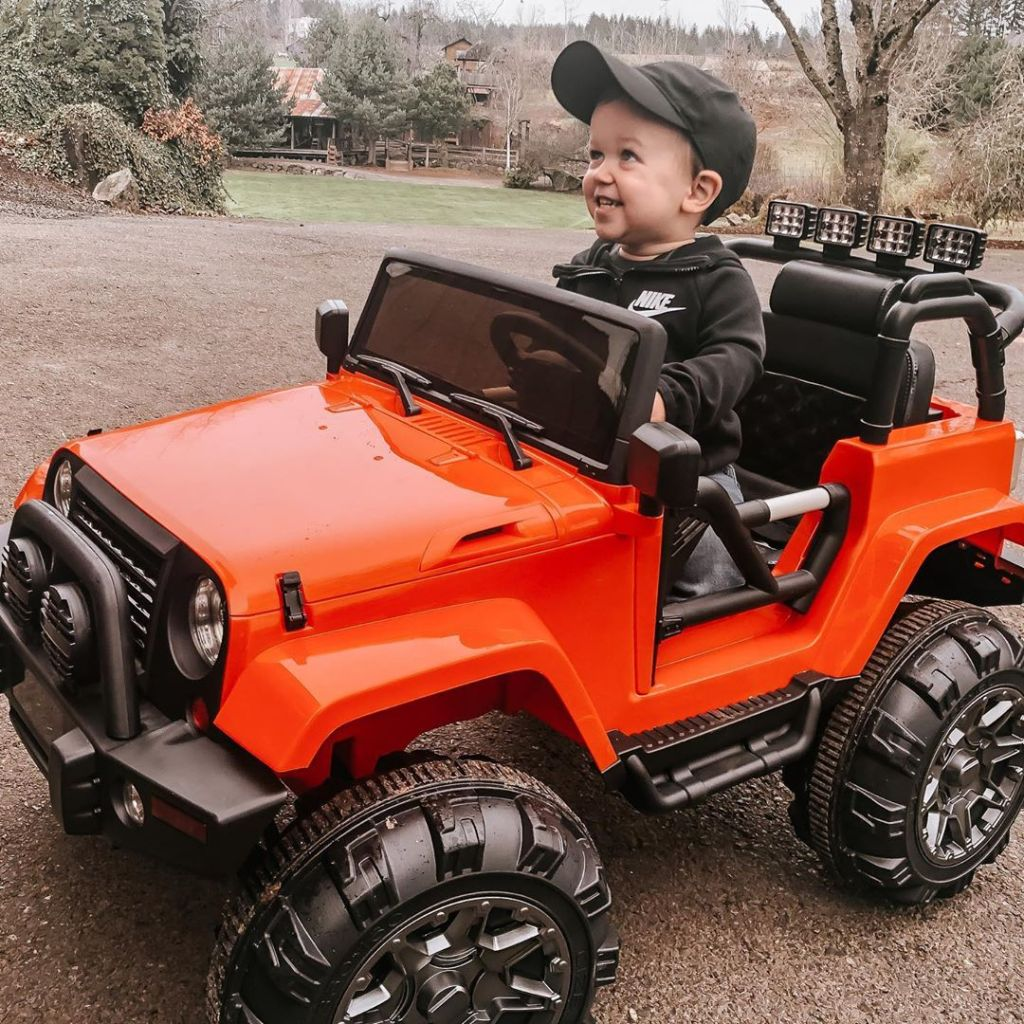 jackson roloff grinning in a toy car