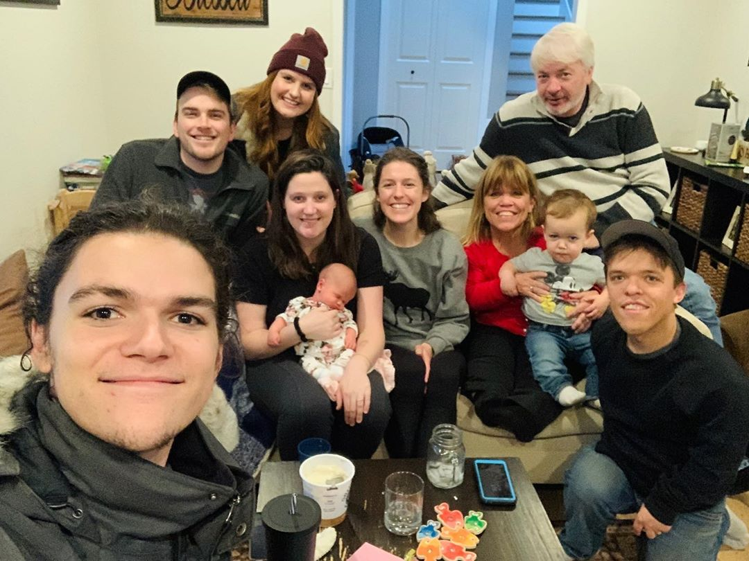 jacob roloff taking a photo of the roloff family at thanksgiving