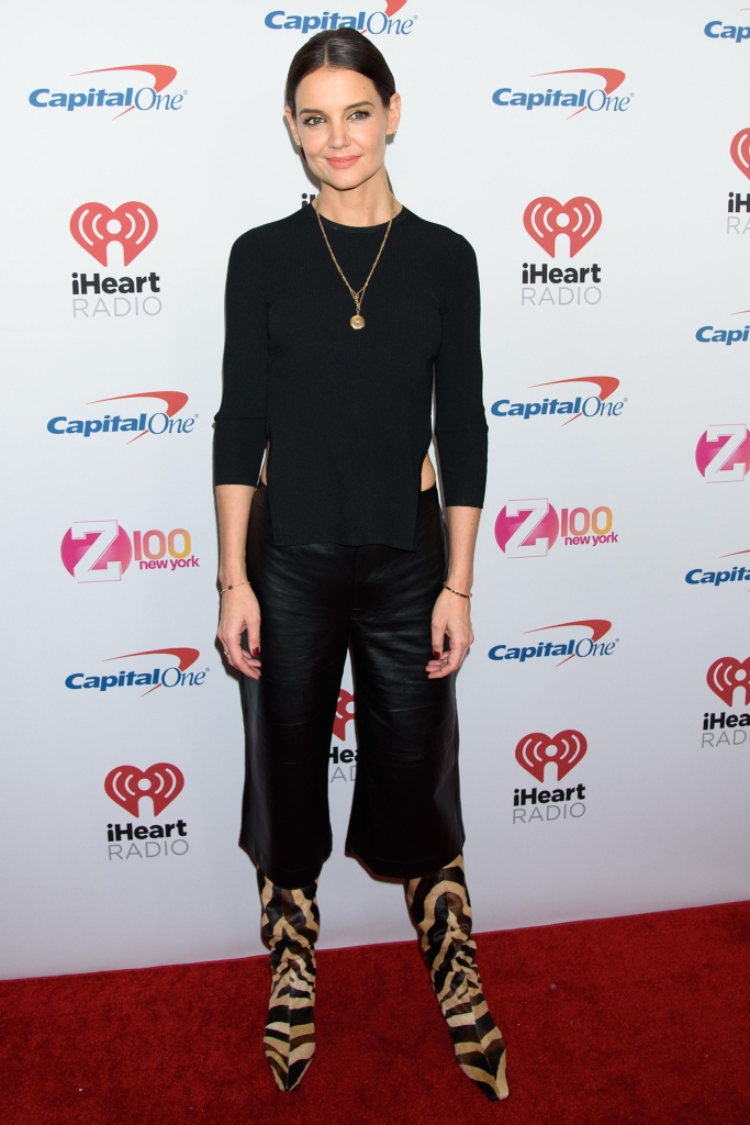 katie holmes looked sexy in an all black ensemble with a high-low cropped long sleeve black top and black leather pants