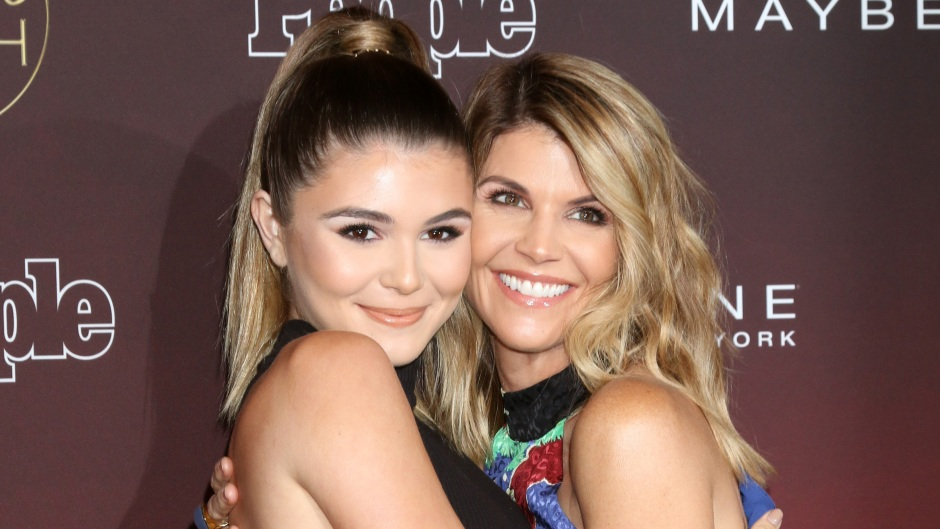 lori loughlin and her daughter olivia jade hugging at a people's ones to watch event