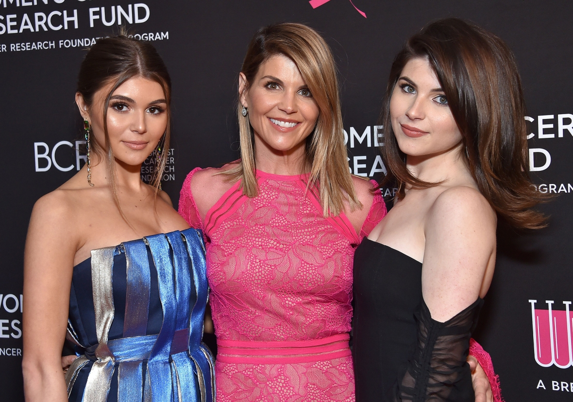 lori loughlin poses at a red carpet event with daughters olivia and isabella