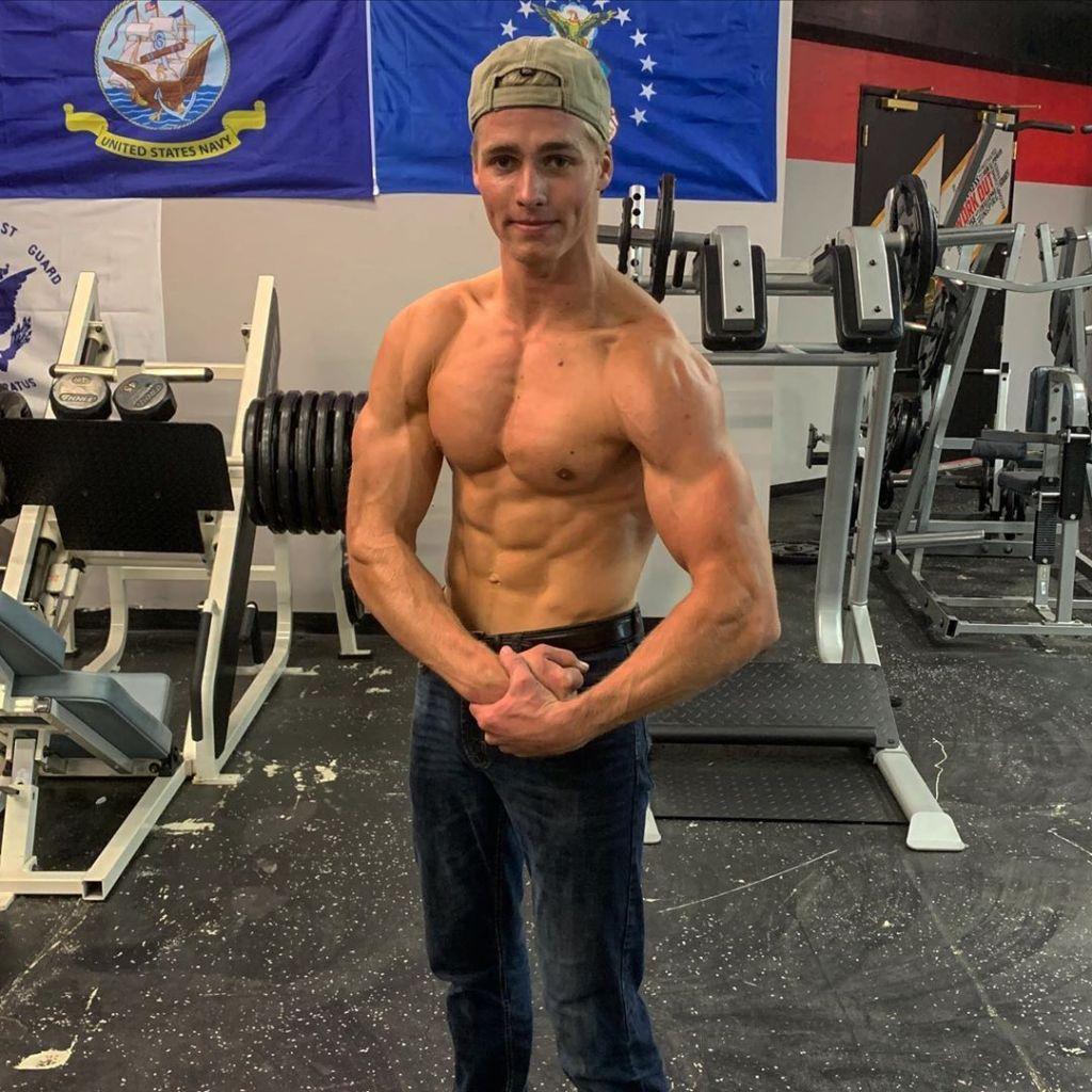 micah plath posing shirtless in the gym