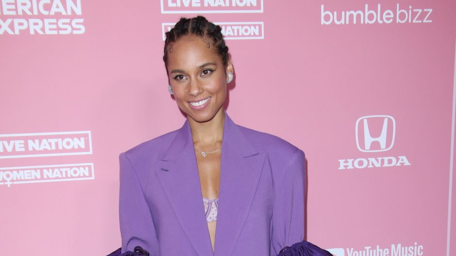 Alicia Keys Wearing a Purple Outfit