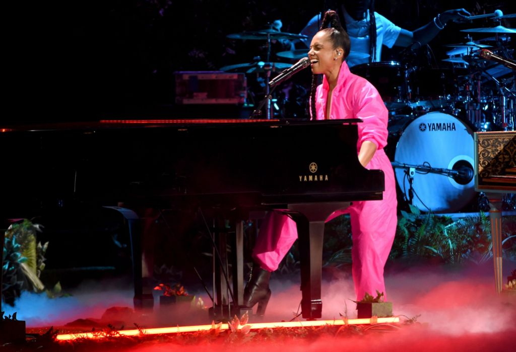 Alicia Keys Wearing Pink Performing on the Piano