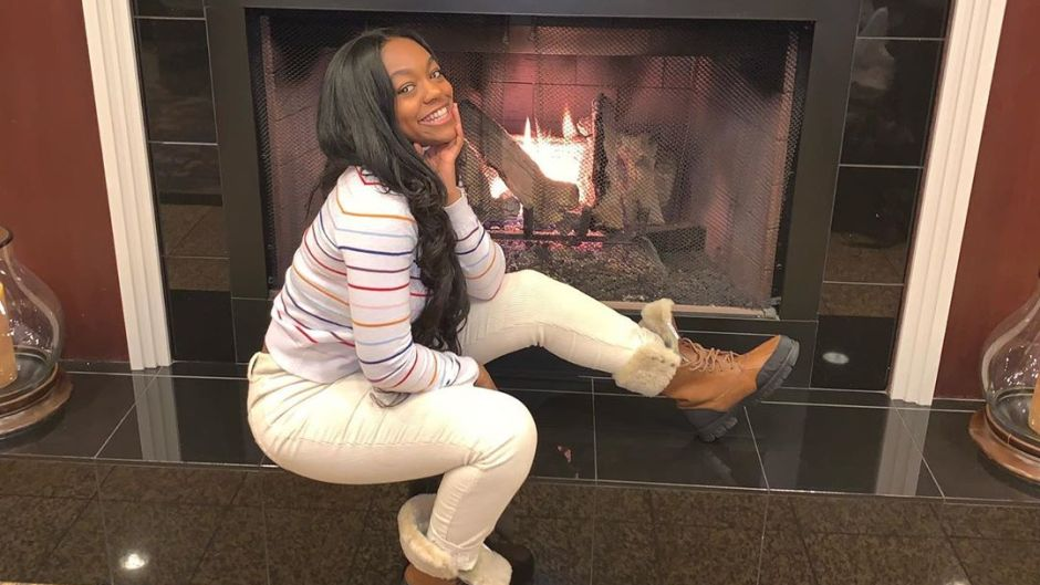 Azriel Clary Wearing Boots By a Fireplace