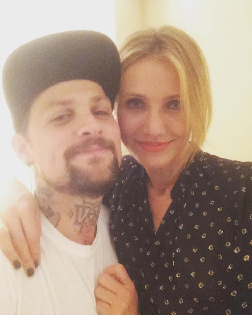 Benji Madden Wearing a White T-Shirt With Cameron Diaz in a Blouse