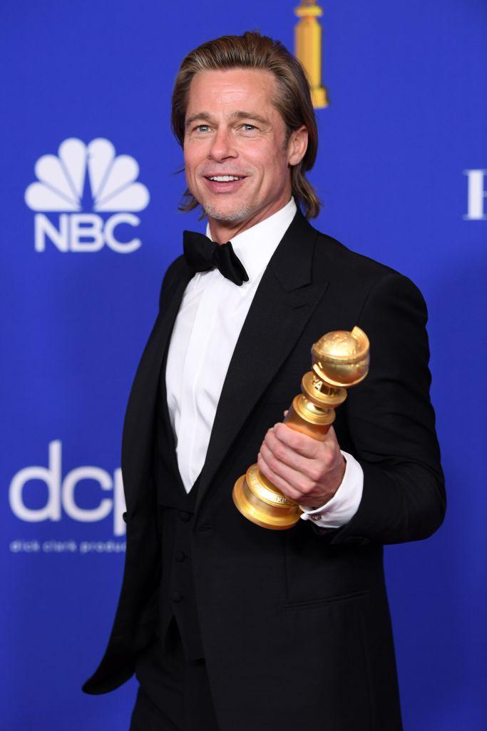 Brad Pitt Holding His Golden Globes Trophy