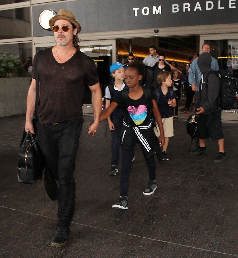 Brad Pitt Wearing a T-Shirt With His Kids