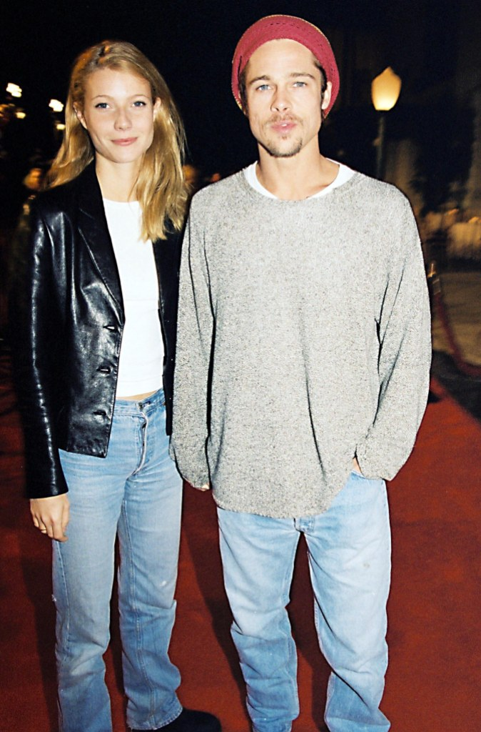 Gwyneth Paltrow Wearing a Black Jacket With Jeans With Brad Pitt in a Sweater and Jeans