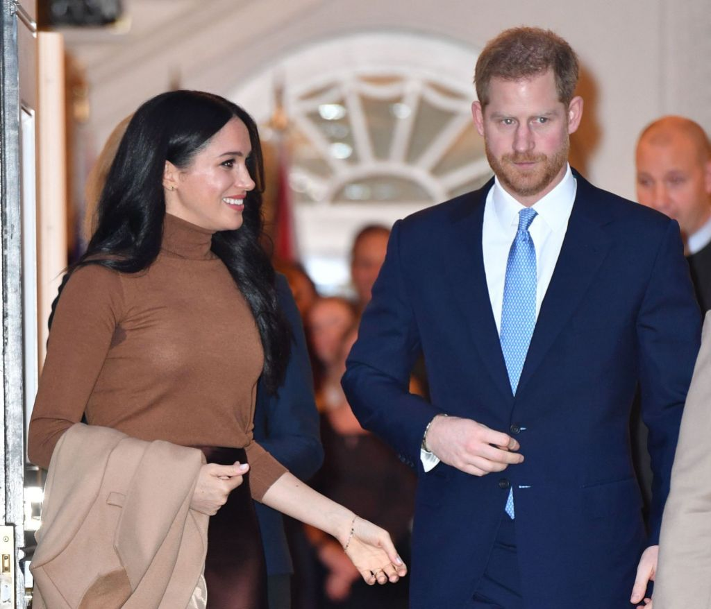 Meghan Markle Wearing a Gold Top With Prince Harry in a Suit