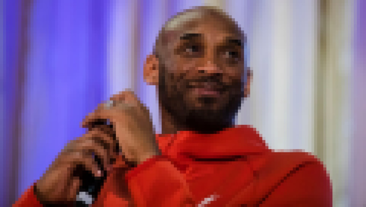 Kobe Bryant Wearing a Red Sweatshirt