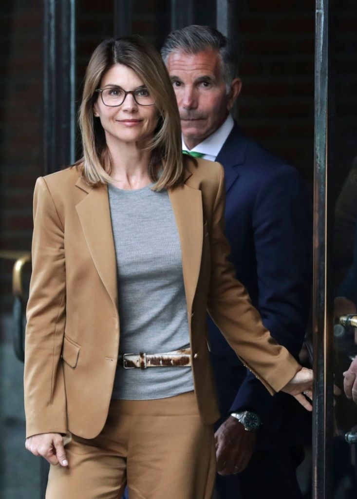 Lori Loughlin, Mossimo Giannulli. Actress Lori Loughlin, front, and husband, clothing designer Mossimo Giannulli, rear, depart federal court in Boston, after facing charges in a nationwide college admissions bribery scandal