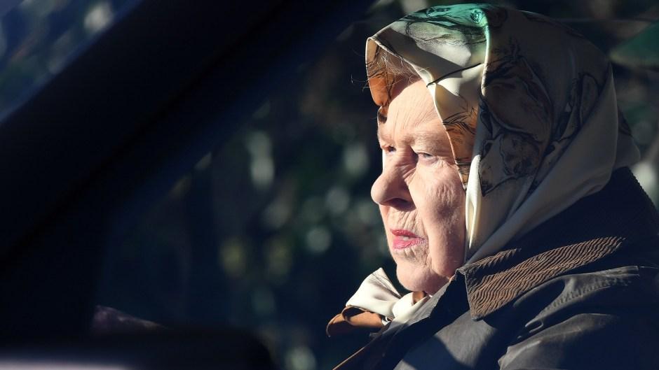 The Queen drives through Sandringham