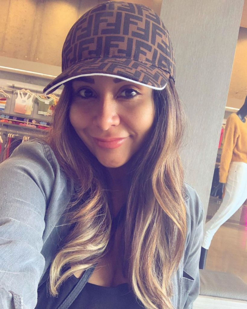 Snooki Wearing a Hat While Taking a Selfie