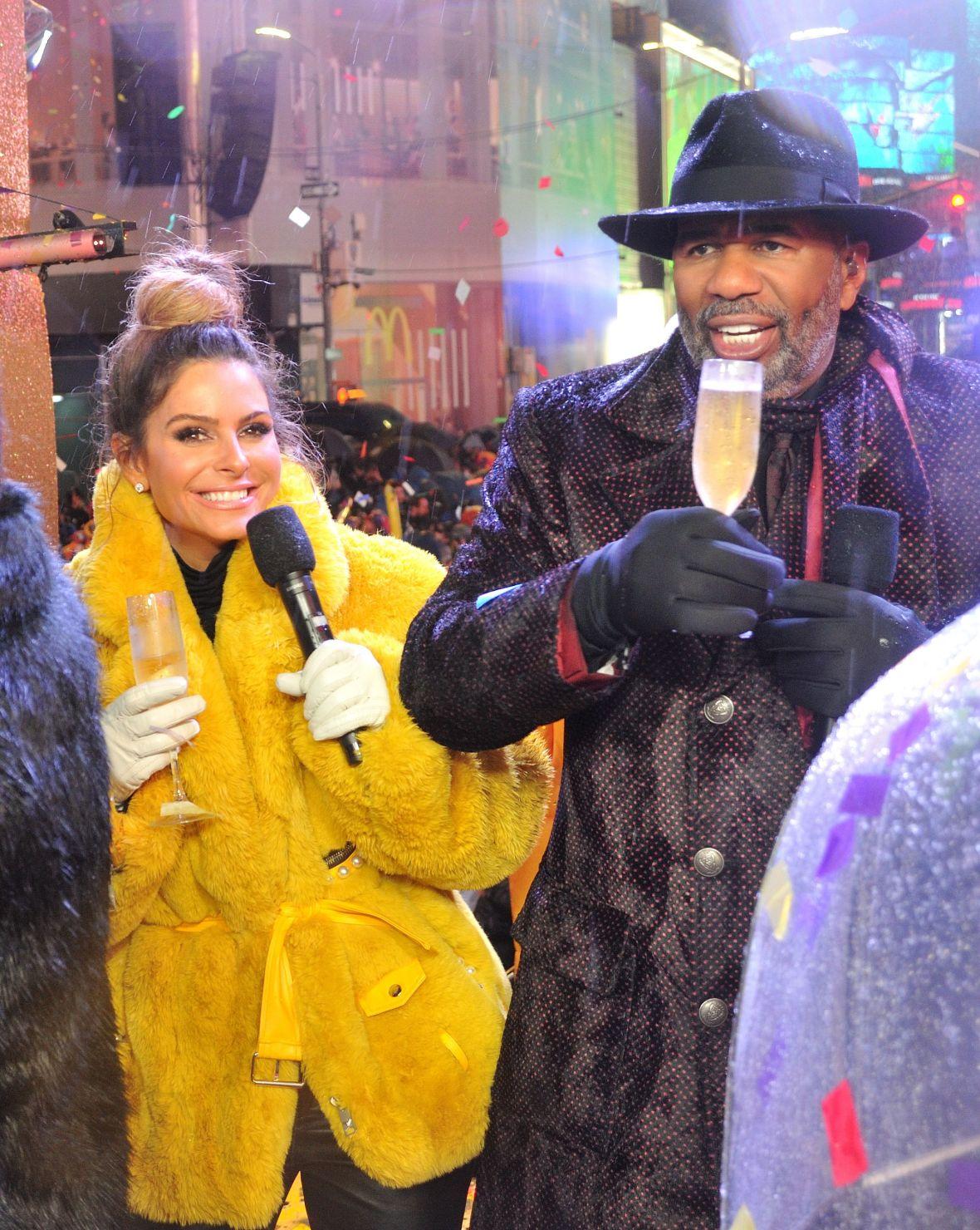 Maria Menuneous Wearing a Yellow Jacket With Steve Harvey