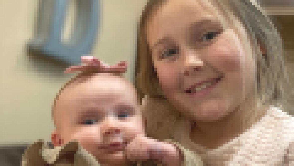 Big Sister Mackynzie Cuddles Baby Maryella