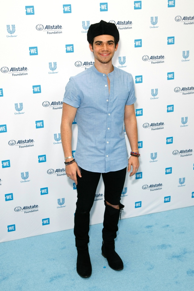 Cameron Boye Wearing a Blue Shirt on a Red Carpet