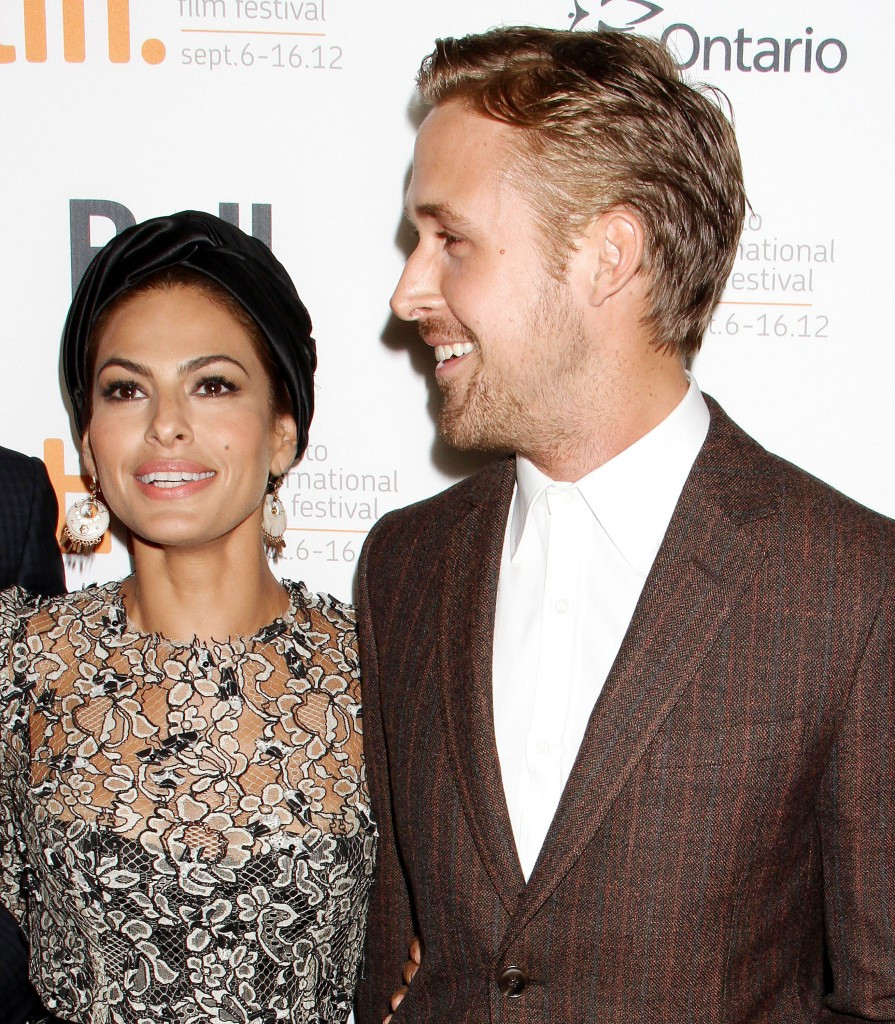 Eva Mendes Wearing a Black Hat With Ryan Gosling in a Suit