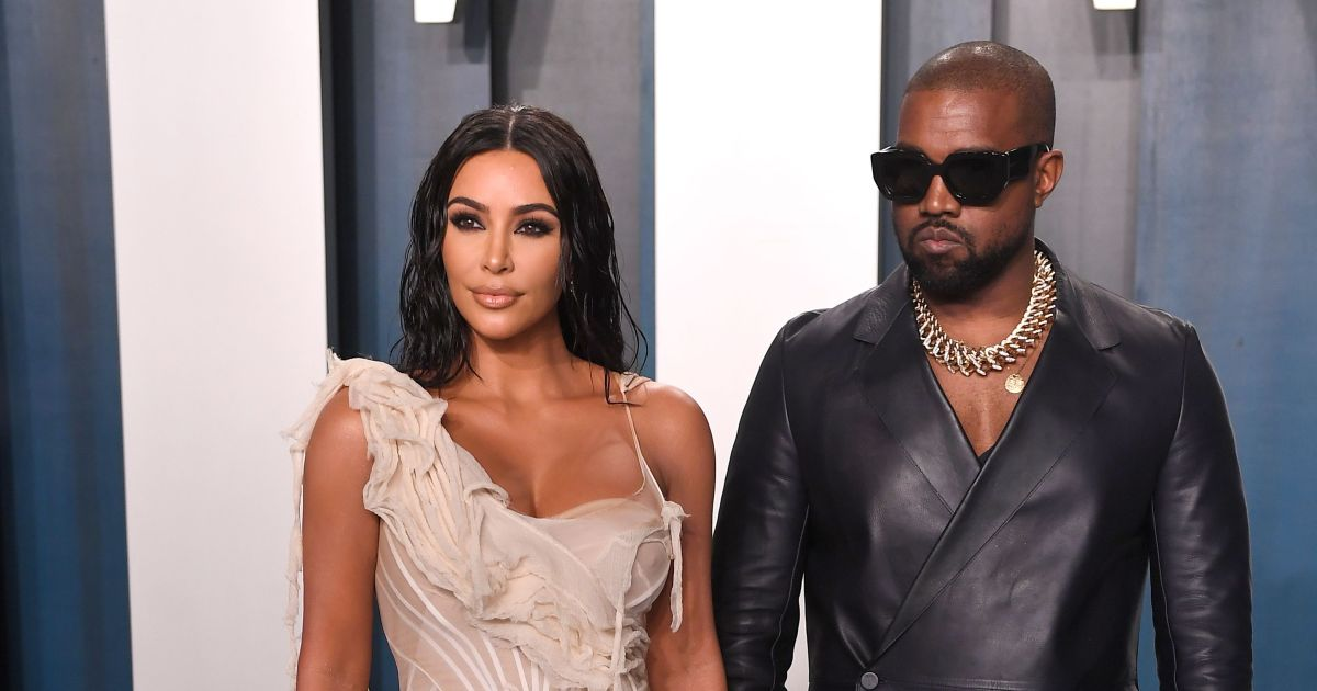 Fans Slam Kanye West for Not Helping Wife Kim Kardashian With Bags