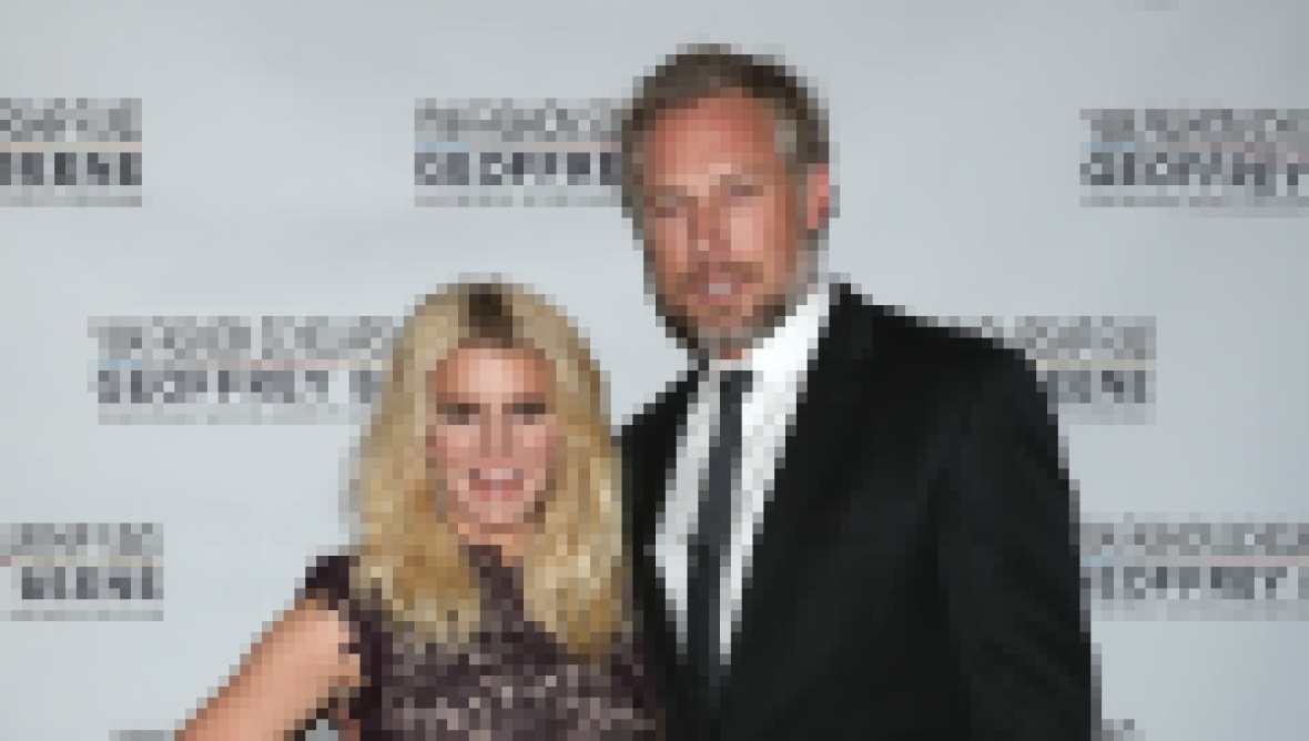 Jessica Simpson Wearing a Black Dress With Eric Johnson in a Suit