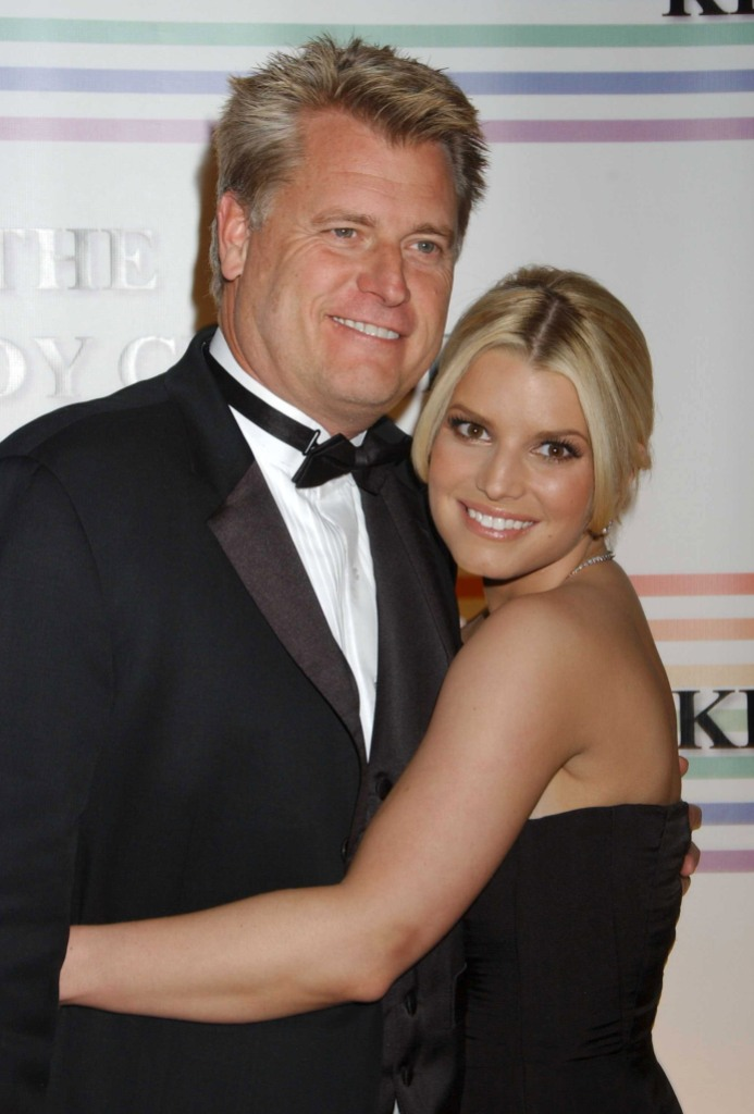 Jessica Simpson Wearing a Black Dress With Her Dad Joe Simpson