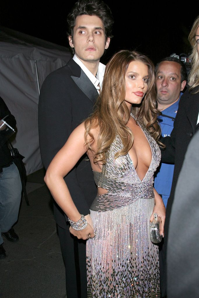 Jessica Simpson Wearing a Gray Dress With John Mayer