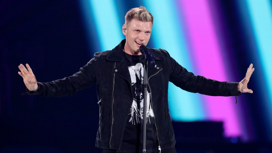 Nick Carter on Stage in a Black Suit