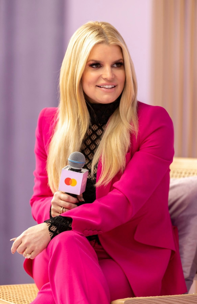 jessica simpson wears a pink power suit at the create and cultivate conference