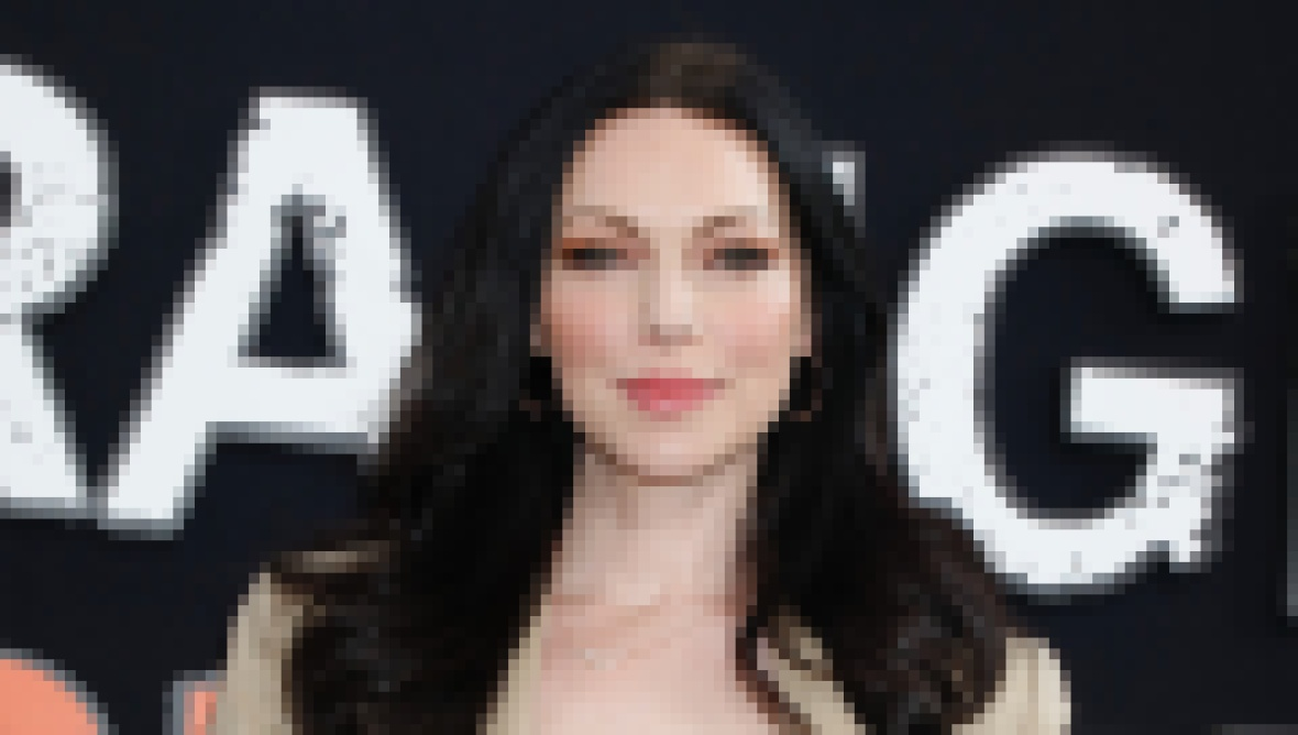 Laura Prepon Smiles in Tan Suit With White Tank Top and Black Hair