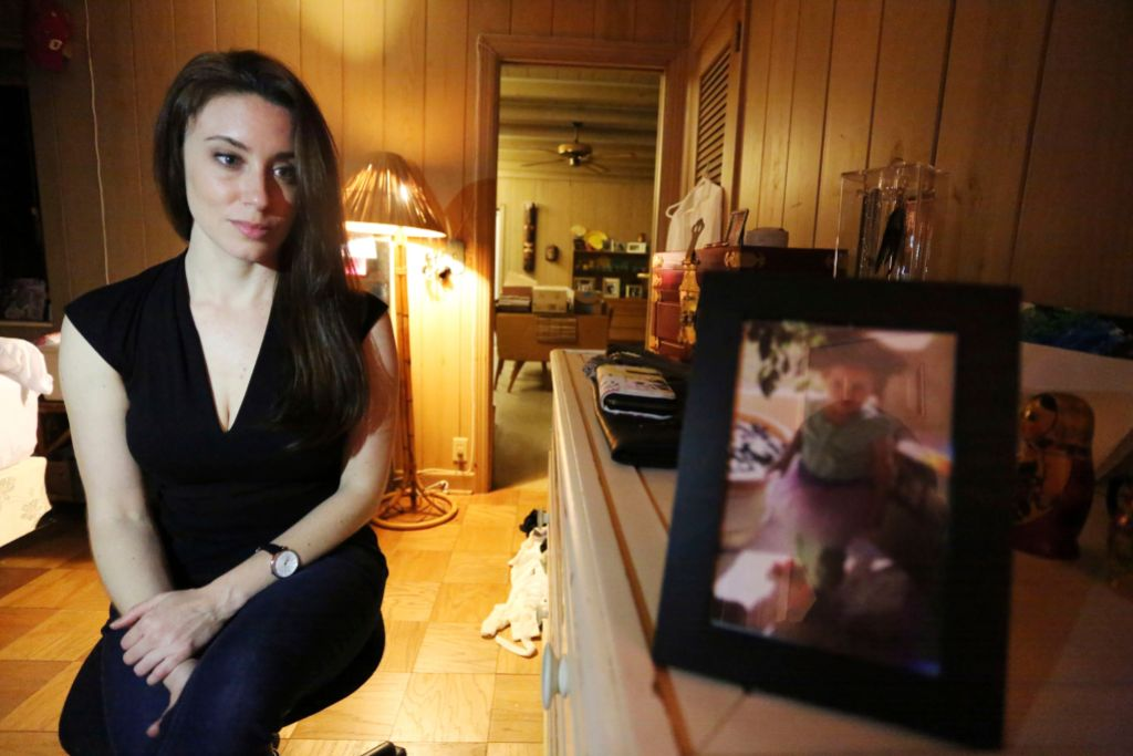 Casey Anthony Looks at Photo of Daughter Caylee
