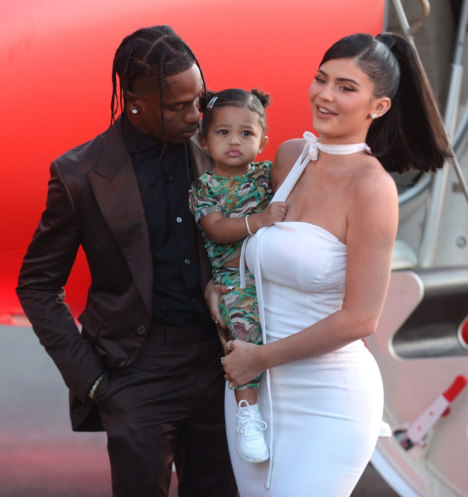 Kylie Jenner Wears White Dress and Smiles While Holding Daughter Stormi Webster at Netflix Premiere With Travis Scott in Brown Silk Suit