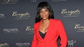 tiffany haddish wears a red pant suit at the borgata