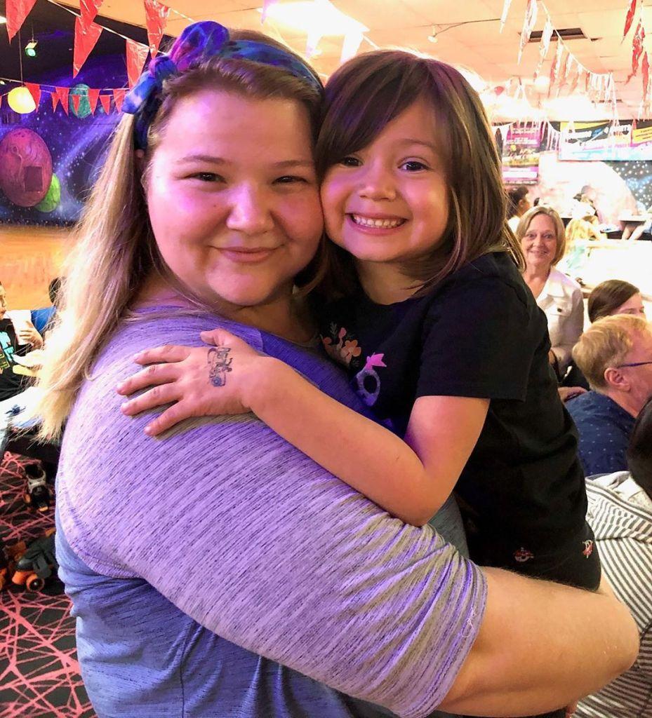 Nicole Nafziger Hugging Daughter May
